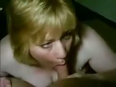 Mature busty woman kills guy, teasing his throbbing penis with her large wet mouth and lengthy soft tongue.