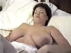 This homemade video is a mix of sexy video scenes I have taken of my huge-titted wife. You can watch her strip, give me blowjob, shave her cunt, masturbate during the time that I fuck her, play with sex toys and take a bath.