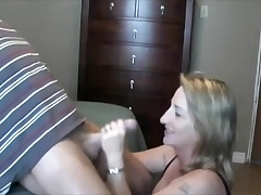This lady can't live without to handle and engulf her husband's cock.  This chick sucks it, puts on some flavored lube, and the strokes the shaft while this chick tonguing the tip in her mouth.  That chap finally cums in her mouth, moaning, and this chick swallows, with just a little bit of the cum dribbling out.