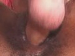 Juicy black cunt acquires nailed by beefy big white cock, which slides back and forth inside this leaking pussy.