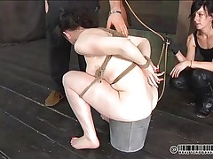 Constipation won't be a problem for Dixon anymore. This babe tried to do it in a bucket but didn't worked so her headmistress inserts a pantyhose in her oiled arsehole and gives the wench an enema. Some other wench is tied on the wall and watches everything, knowing that she's next. Does Dixon feels humiliated enough or this babe needs more?