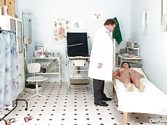 Naked Mature lady with big tits visits the doctor for her pussy examination. That babe is ordered to lay on the patient's daybed doctor examines her stomach and then wears his gloves and tells her to spread her legs so that her cunt can be tested. Doctor examines it and then checks her wazoo and ask her if that babe had anal sex ever that babe replied with no.