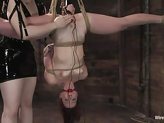 Claire Adams has Trinity Post's vagina wired. She's not only fastened up but upside down, and gagged to boot. She's got a metal plug in her cunt and Claire's using a sextoy on her clit, making her crave to cum. That babe gets permission to cum and that babe does several times, moaning loudly throughout her ball gag.