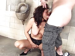 She's a bawdy whore and does everything a man asks her. Here she is, in an abandoned public latrine engulfing this chap and then licking his anus before that guy bonks her from behind. She's a cougar that enjoys a good bawdy fuck and probably will enjoy his sex cream too so stick with us and watch this wench in full act