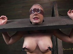 Clamps with weights were attached on her big boobs and duct tape was used to blindfold her. Now that babe stays there in that thraldom device and has a rodeo sex machine underneath her that's rubbing her shaved pussy. To make things interesting an executor comes and deeply mouth bonks this slut girl, chocking her with pecker
