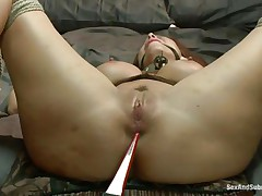 Tied on the sofa and ball gagged this bitch receives some shocks with an electric wand. The executor pays particular attention to her nipps and wazoo hole. Now it's time for some hard whipping on these hawt thighs and wet pussy. It looks like she's ready for a hard fuck but still needs some spanking on that cunt