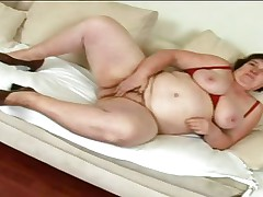 This brunette hair mommy is sitting naked on her ottoman and that sweetheart is fingering her big sexy vagina. That sweetheart is playing with her heavy breasts also becoming very horny. That sweetheart is fortunate because a guy with a big cock appear and the doxy is doing a great oral to him. This chab surely will fuck her hard and deep.