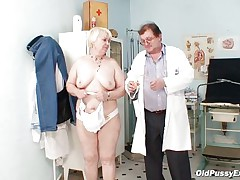 Bozena is a older lady with big boobs, horny face and big ass. After doctor asks her to strip this man is using a sucking machine to make her nipples harder. This doc has a impure mind and surely this man is making her horny, who knows what tricks this man has to make this old floozy willing to fuck.
