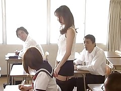 Manami Suzuki can't live without teaching. Someone's out to expose her for the bitch that babe actually is, hitting the remote control of her vibrator, causing her to groan as that babe walks through the class. A student's father comes in, his son saying the teacher's a porn star. Pretty in a short time she's stripped in front of the class.