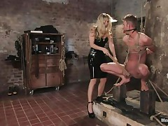 That babe got her guy tied nice-looking nice and now she's having some joy with his body, paying a lot of special attention to his cock. This sexy bossy milf with blonde hair and fit body is using her tools to taunt and induce pain to her man. Look at her spanking his 10-Pounder and body as he's tied up and ball gagged.