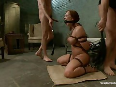 This brown hot floozy is a prisoner of this 2 guys. This babe is naked and bounded and this babe sits on the floor and waits to be punished by those males with large cocks. One of them bonks her throat and after that he penetrates her wet vagina. The slut screams of pleasure and this babe is ready for a threesome.