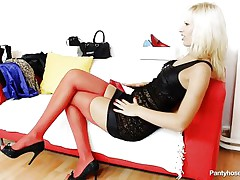 This golden-haired slut wearing red pantyhose is sitting on the bed with a horny male. They start touching and playing each other body, so the guy takes off her small pants and start to lick her pussy. While he licking the cookie he find inside some other pair of pantyhose and takes it out from there.