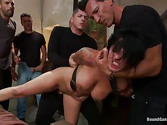Eva Angelina is a white 27 years old american girl with a nice couple of mangos which has the bad luck to be surrounded by five horny guys who like rough fucking. They test her mouth size by inserting their dicks so deep until she can't even breathe. Next, they widen her legs and alternative fuck her