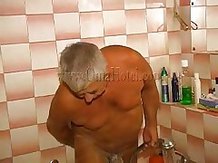 The old fart is taking a shower when his woman comes to assist him wash. They may be old but they still have some excitement for every other and soon a easy shower turns into a shower fuck! The granny takes off her garments and joins him and he starts rubbing and soaping those saggy tits and then rub her pussy.