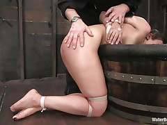 The old, experienced executor is showing this youthful cutie what he is capable of. That guy tied her hands and legs and grabbed her by the neck so he could put her head underneath water. That babe is wet and dominated and looks like this whore enjoys her situation a lot, especially when he slaps her ass and uses a sex tool to stimulate her clit.