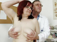 Dark brown older lady is lying on the gynecologist's table and the doctor is examining her pussy. This fellow is wearing gloves and fingering her cookie right after that fellow examines her worthy miniature tits. This fellow is inserting a thin medical tool in her tight ass. You really needs to see where the doctor ends up.