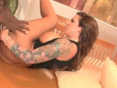 Tattooed bitch takes it in one as well as the other holes