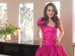 Hawt beauty in a pink suit strips solo