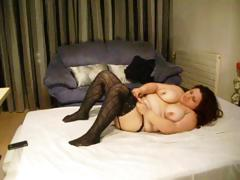 Fat brunette hair wearing darksome stockings sticks dildo in her fat cum-hole