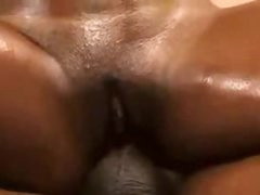 Slick black chick fucked by large black cock