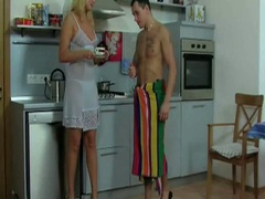 Golden-haired milf gets nailed in the kitchen